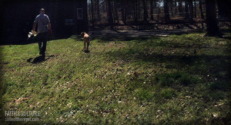 Dog following his master